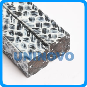 Carbonized fiber packing impregnated with PTFE